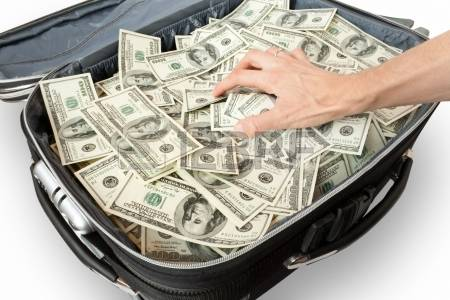 6143374-greed--lot-of-money-in-a-suitcase-with-hand.jpg